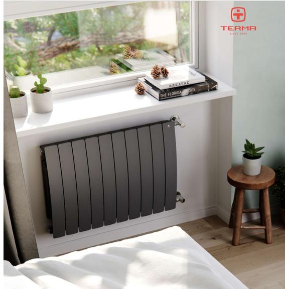 TERMA Camber vodný radiátor pod okno - v interiéri